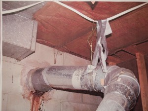 Hanging vent pipe from electrical wire